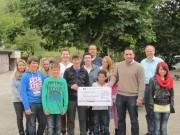 Spendenübergabe für Ruanda